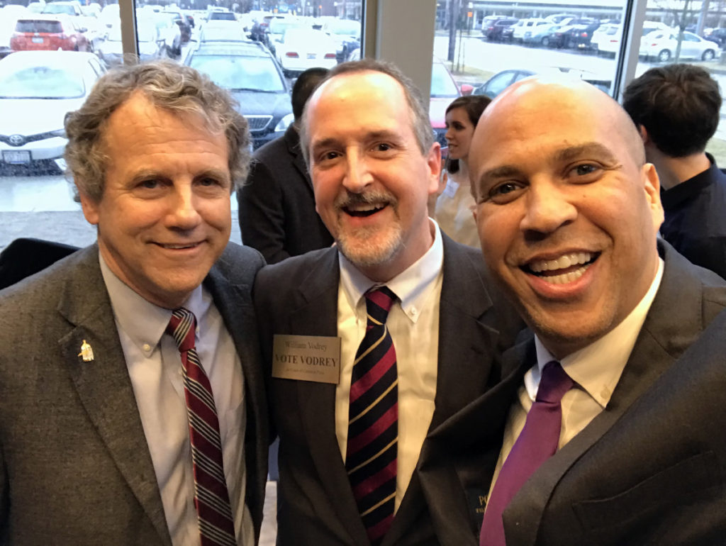 William with U.S. Senators Sherrod Brown and Cory Booker